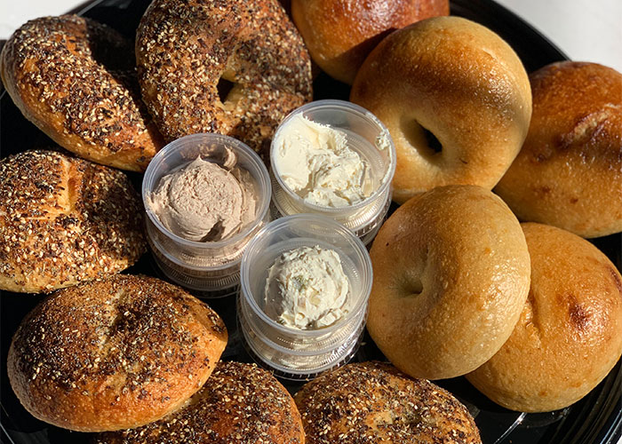 Platter of bagels of spreads